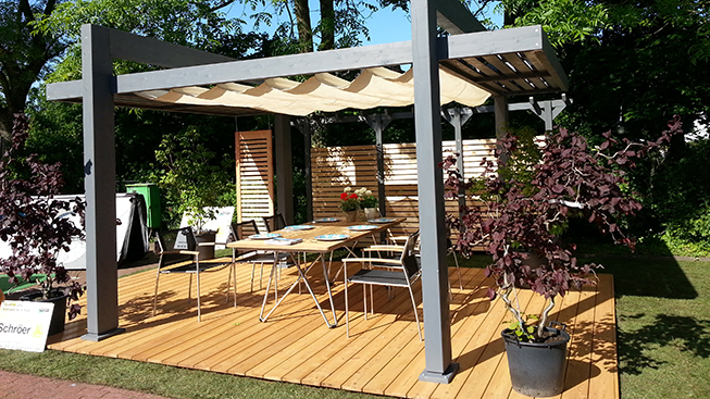 Holz-Schröer Ausstellung. Parkett, Terrassenhölzer, Carports, Gartenmöbel und Gartenhäuser