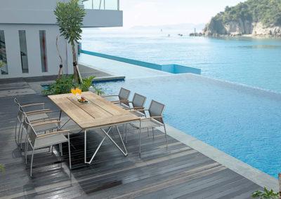 CS Edelstahl Rundrohr Tisch mit Rovex Sessel